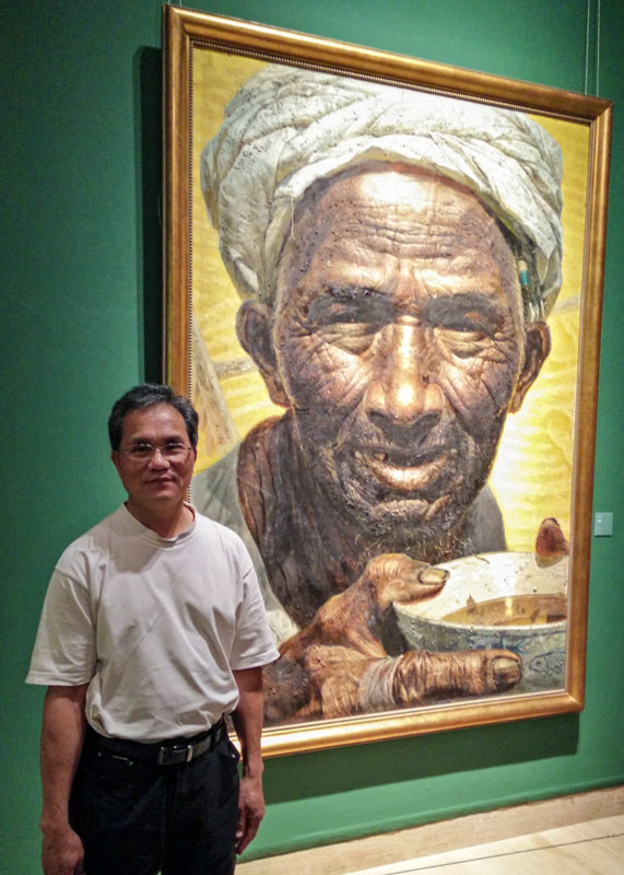 Xincai Tan at the National Art Museum of China Beijing with famous Chinese painting 'Father' by Zhongli Luo